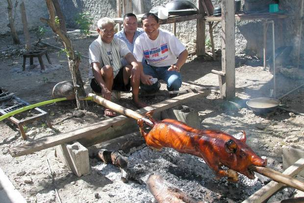 my father on the right 10yrs ago, participating in the world famous Carcar Lechon at his home