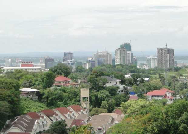 Western style track homes in the foreground and the ever growing skyline of Cebu